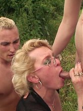 Sexy grandma goes with them to the country where they fuck her pussy with their dicks