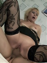 Sexy older woman Lina joins a pretty younger redhead in double teaming a grateful guy