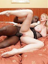 Blonde mature Monik exposes her pair of big breasts and enjoys interracial sex on webcam